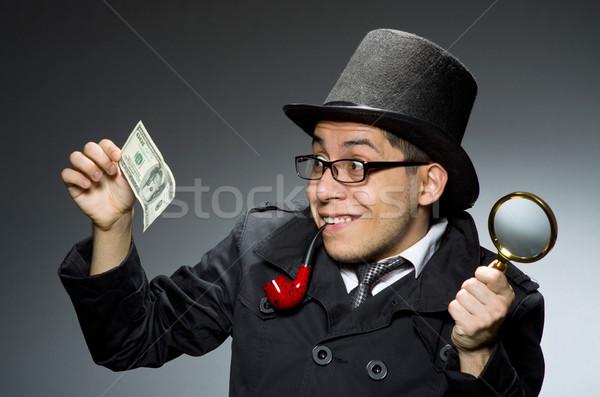 Jovem detetive preto casaco dinheiro cinza Foto stock © Elnur