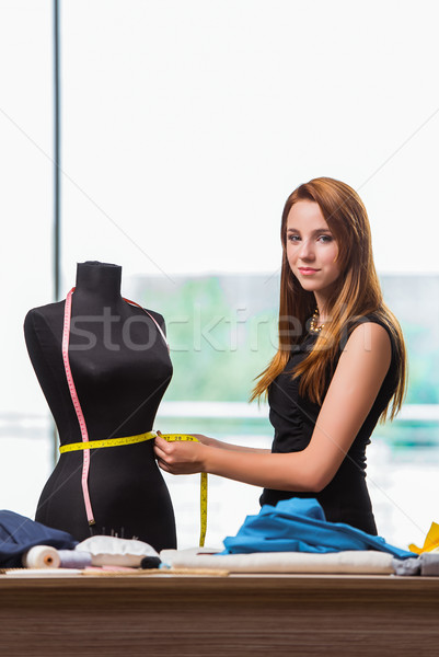 The woman tailor working on new clothing Stock photo © Elnur