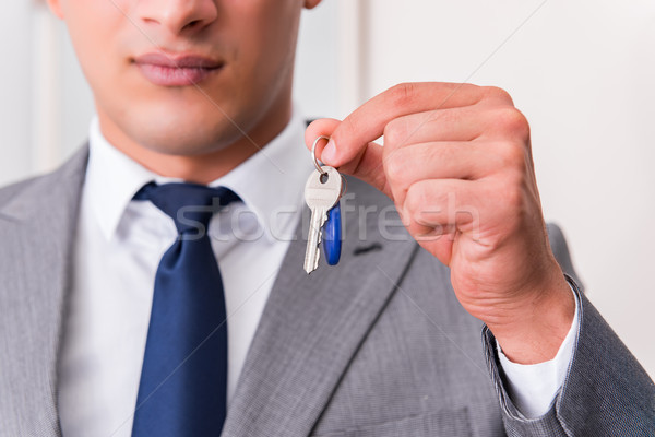 Businessman in real estate concept with home key Stock photo © Elnur