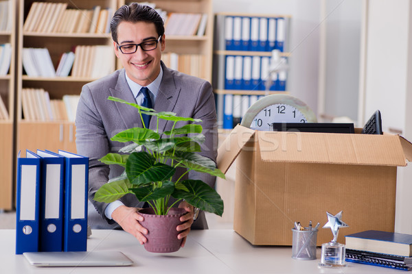 Man moving office with box and his belongings Stock photo © Elnur