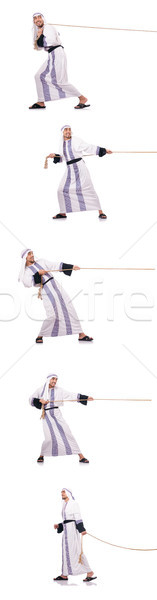 Arab man in tug of war concept Stock photo © Elnur