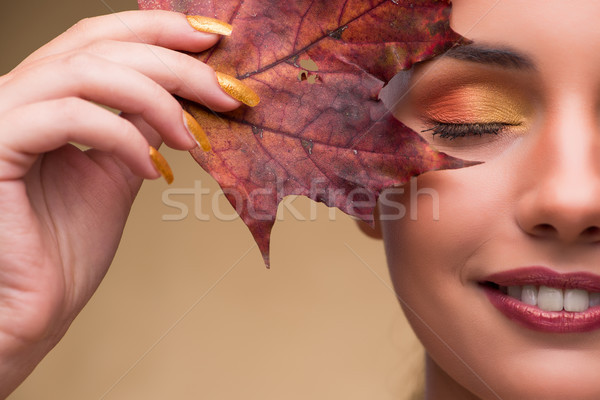 Beautiful woman in with autumn dry leaves Stock photo © Elnur