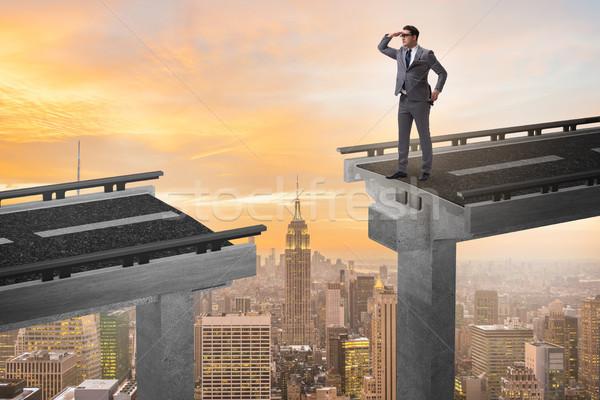 The businessman ready to overcome the broken bridge Stock photo © Elnur