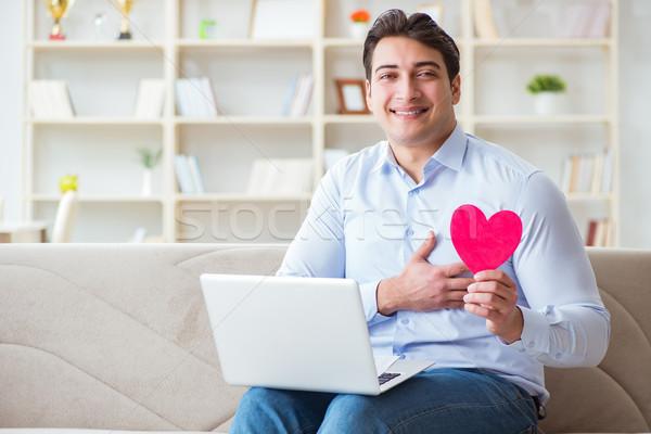 молодым человеком брак предложение интернет ноутбука Сток-фото © Elnur