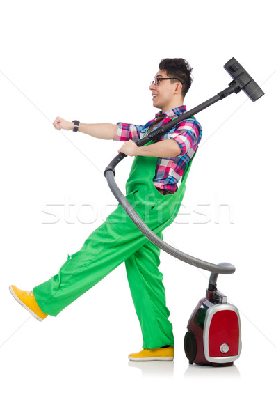 Funny man in green coveralls vacuum cleaning Stock photo © Elnur