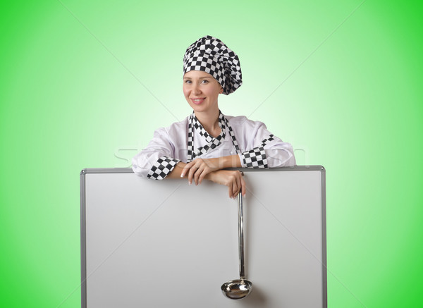 Cook with ladle and blank board Stock photo © Elnur