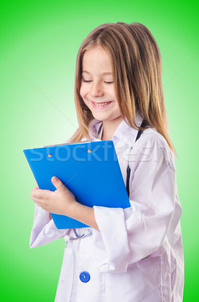 Stock photo: Little girl in doctor costume
