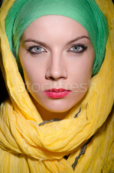 Serious woman wearing colourful headscarf Stock photo © Elnur