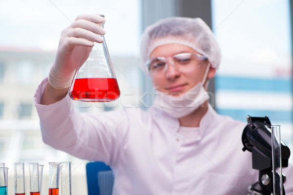 Man working in the chemical lab on science project Stock photo © Elnur