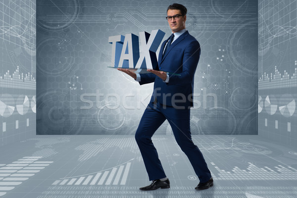 Man under the burden of tax payments Stock photo © Elnur