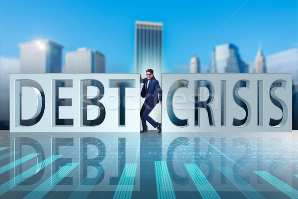 Businessman squeezed between crisis and debt Stock photo © Elnur