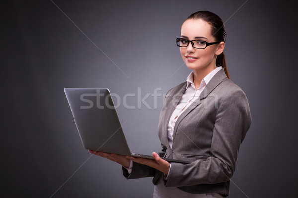 Businesswoman with laptop in business concept Stock photo © Elnur