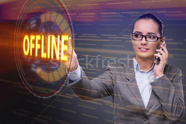 Businesswoman pressing virtual button offline Stock photo © Elnur