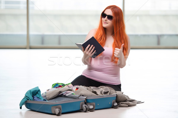 The young woman packing for travel vacation Stock photo © Elnur