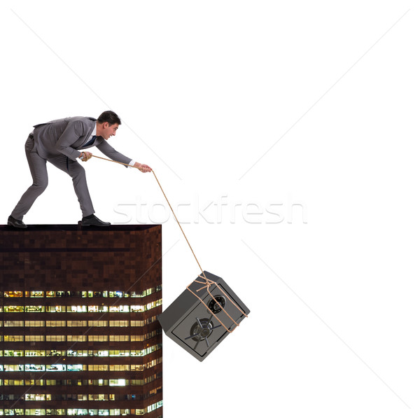 Businessman stealing safe from building Stock photo © Elnur