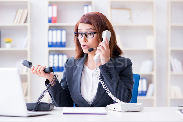 Frustrated call center assistant responding to calls Stock photo © Elnur