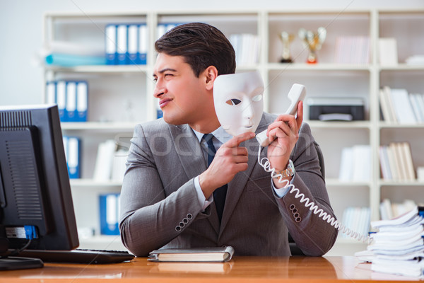 The businessman with mask in office hypocrisy concept Stock photo © Elnur