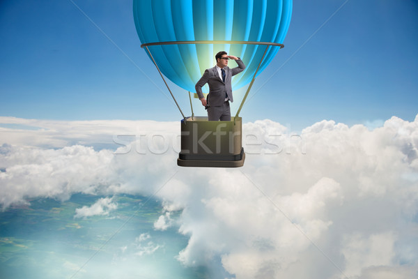 Businessman flying on balloon in challenge concept Stock photo © Elnur