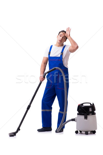 Man in coveralls doing vacuum cleaning on white Stock photo © Elnur