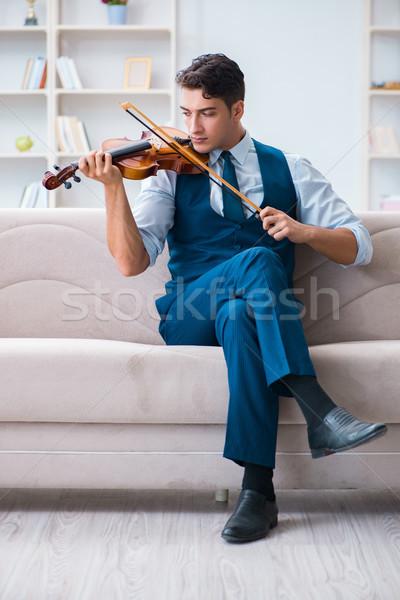 молодые музыканта человека играет скрипки Сток-фото © Elnur