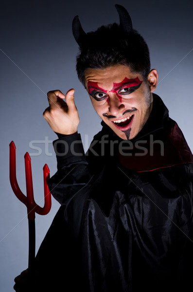 Homem diabo traje halloween sorrir sensual Foto stock © Elnur