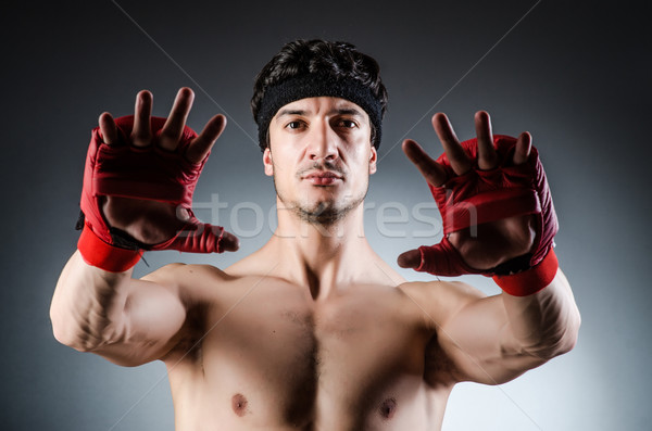 Muscular boxer wiith red gloves Stock photo © Elnur