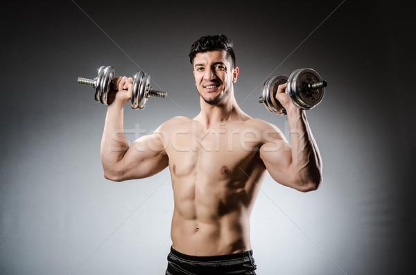 мышечный Культурист гантели спорт фитнес здоровья Сток-фото © Elnur