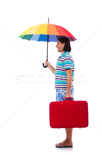 Traveler with red case  and umbrella isolated on white Stock photo © Elnur
