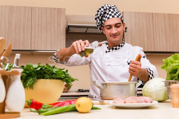 The young chef working in the kitchen Stock photo © Elnur