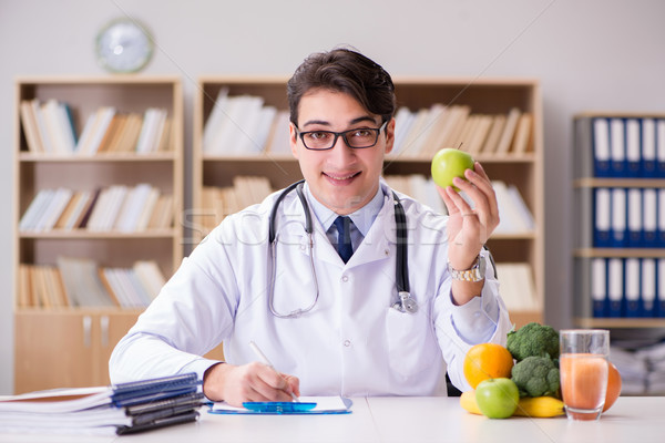 The doctor in dieting concept with fruits and vegetables Stock photo © Elnur