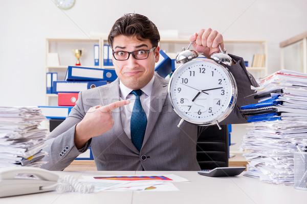 Businessman missing deadlines due to excessive work Stock photo © Elnur