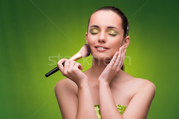 Young woman in beauty concept on green background Stock photo © Elnur