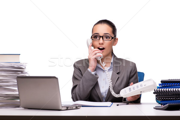 Stock photo: Young businesswoman in office isolated on white