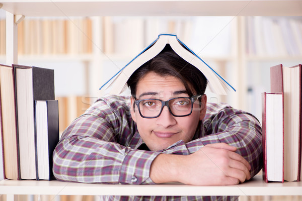 Young student looking for books in college library Stock photo © Elnur