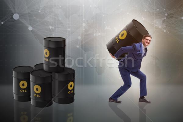 Businessman under the burden of oil barrel Stock photo © Elnur