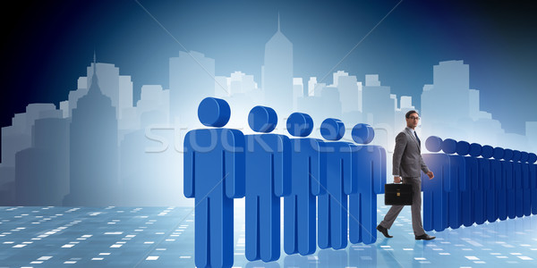 Standing out from crowd concept with businessman Stock photo © Elnur