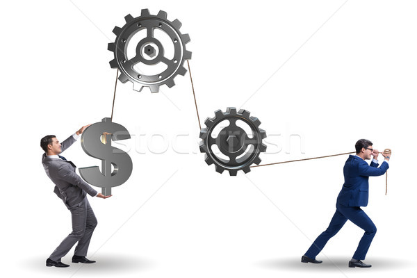 The businessman pulling mechanism and raising dollar Stock photo © Elnur