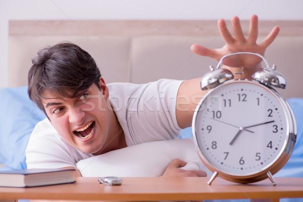 Hombre cama frustrado sufrimiento insomnio alarma Foto stock © Elnur