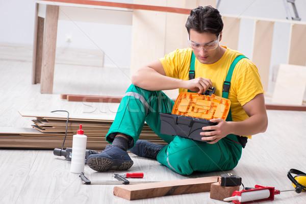 Contractor working on laminate wooden floor  Stock photo © Elnur