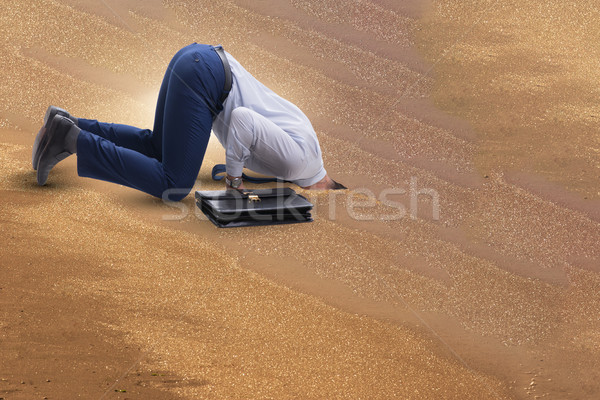 Businessman hiding his head in sand escaping from problems Stock photo © Elnur