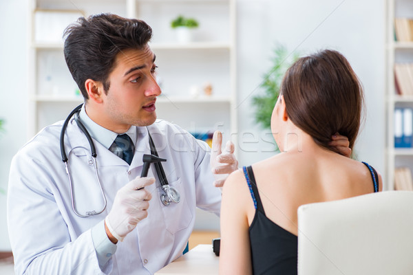 The doctor checking patients ear during medical examination Stock photo © Elnur