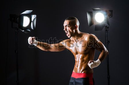 Muscular actor with mask against curtain Stock photo © Elnur