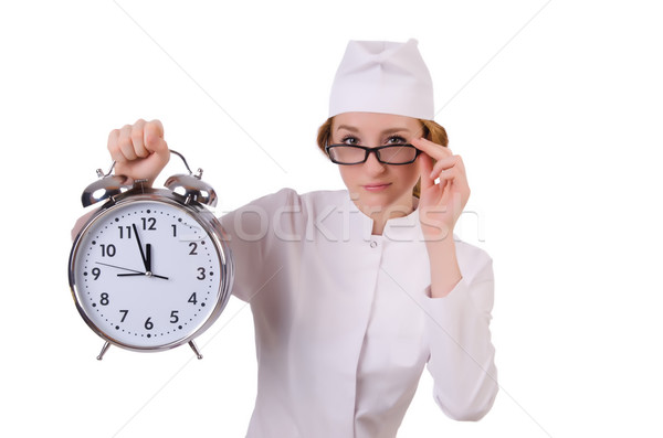 Attractive woman doctor with big clock  isolated on white Stock photo © Elnur