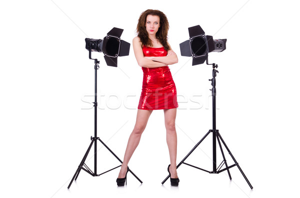 Woman in red dress posing in the studio Stock photo © Elnur