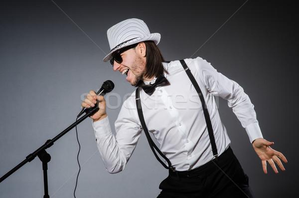 Vicces énekes mikrofon koncert férfi boldog Stock fotó © Elnur