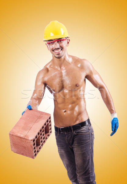 Muscular construtor tijolos branco construção trabalhar Foto stock © Elnur