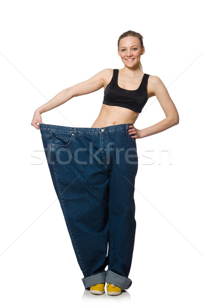 Dieting concept with big jeans on white Stock photo © Elnur