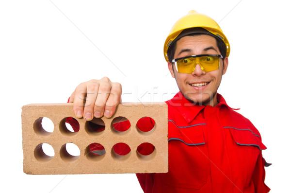 Travailleur de la construction argile briques blanche construction fond Photo stock © Elnur