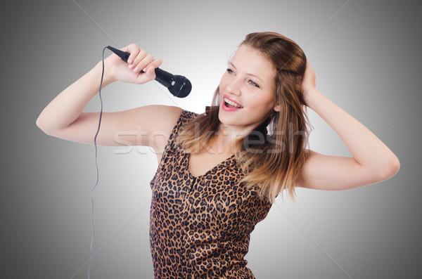 Mulher cantora microfone branco menina festa Foto stock © Elnur