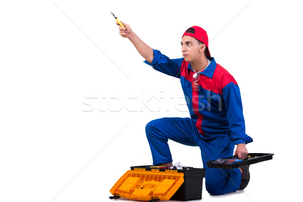 Young repairman with wrench spanner isolated on white Stock photo © Elnur